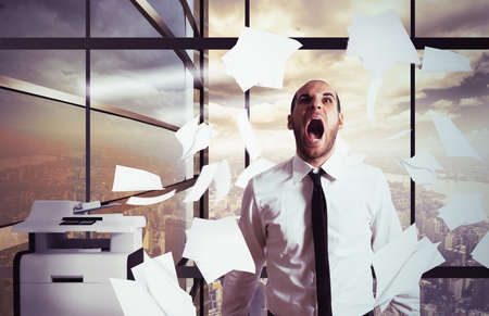 office documents: Businessman stressed and overworked yelling in office