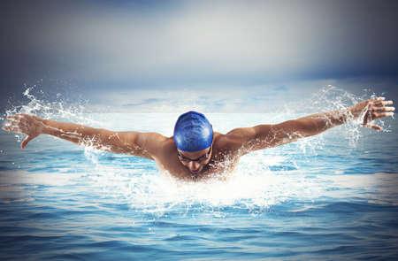 Professional man swimmer swims in open sea