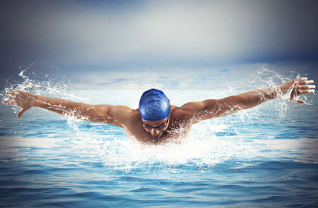 swimming goggles: Professional man swimmer swims in open sea