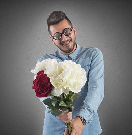 infatuation: Nerd boy woos with a flowers bouquet