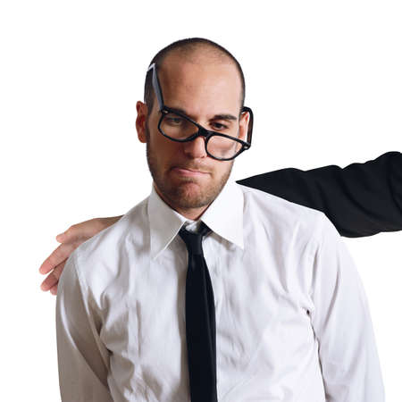 comforted: Sad businessman comforted by a friendly colleague