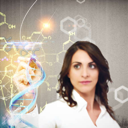 Woman chemist explain chemical formulas in laboratory Archivio Fotografico