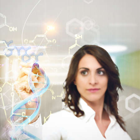 research education: Woman chemist explain chemical formulas in laboratory Stock Photo