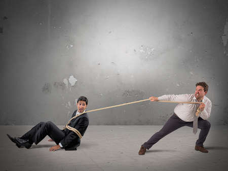 office slave: Manager alloy forcing an employee to orders Stock Photo