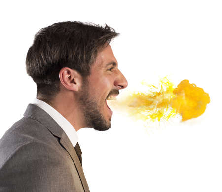 personas enojadas: Hombre de negocios agresivo escupe fuego por la boca Foto de archivo