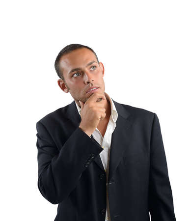 interrogative: Businessman reflects on what decision to take Stock Photo