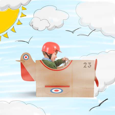 carton: Ni�o vuela con su avi�n de cart�n