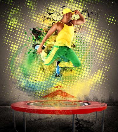 trampoline: Fitness teacher jumps nimbly on the trampoline Stock Photo