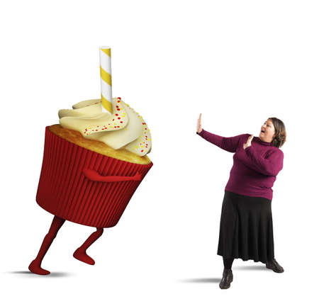 Fat woman is frightened by giant cupcake
