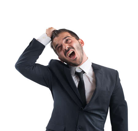 agression: Crazy businessman stressed out from work screams Stock Photo