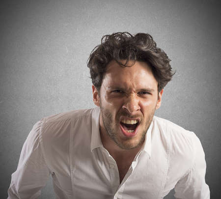 stressed out: Angry businessman stressed out from work screams