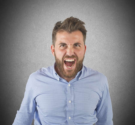 aggressive: Aggressive businessman stressed out from work screams Stock Photo