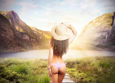 hot ass: Girl back in bikini in natural landscape Stock Photo
