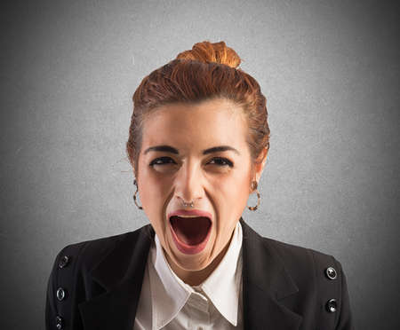 Businesswoman stressed and frustrated screams at work