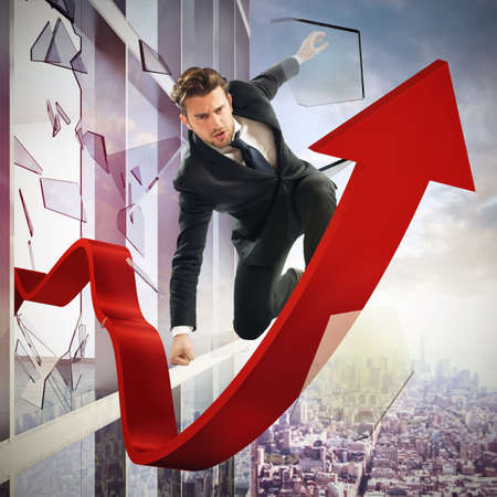 statistical: Determined businessman over a big red arrow Stock Photo