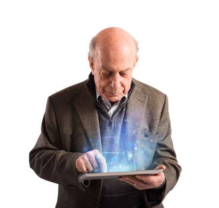 Senior uses tablet to surf the internet Stock Photo
