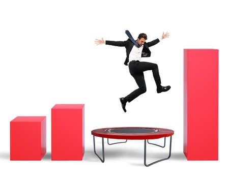 Businessman jumps on the trampoline between statistics