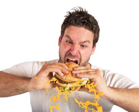 comiendo: Hombre comiendo un s�ndwich con �mpetu violento