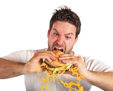 food dressing: Man eating a sandwich with violent impetuosity