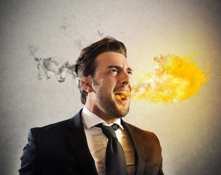 pissed: Business man pissed and furious spitting fire