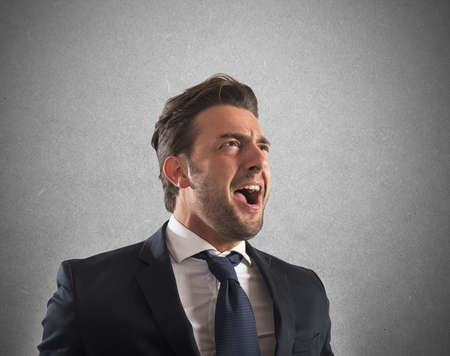 agression: Business man pissed and furious at work Stock Photo