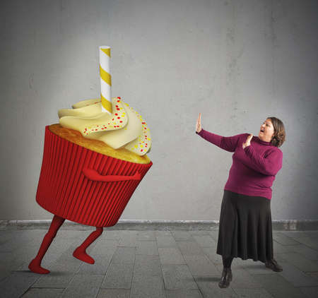 frightened: Fat woman is frightened by giant cupcake