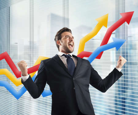 exult: Businessman yells to delight of economic triumph