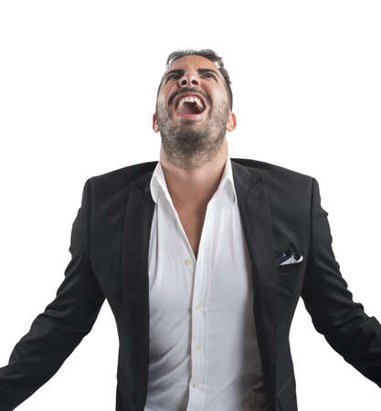 desperate face: Anxious businessman stressed out from work screams