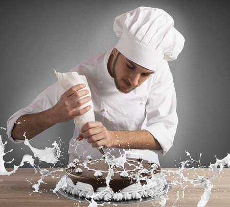 decorates: Pastry chef decorates a cake with cream