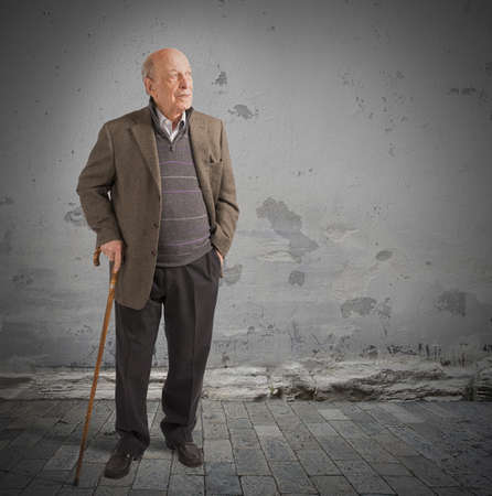 old people walking: Health elderly man walking with his stick Stock Photo