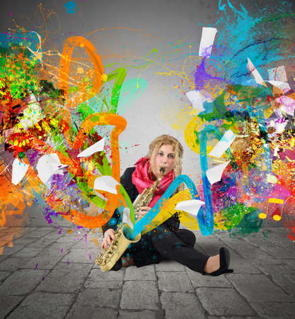 Girl musician plays trumpet with colorful trails photo