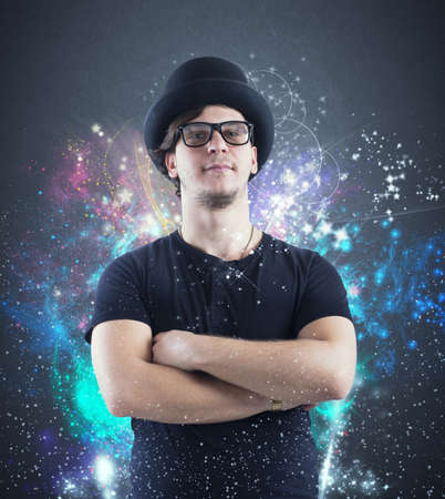 twinkling: Boy charming magician with colored twinkling lights Stock Photo