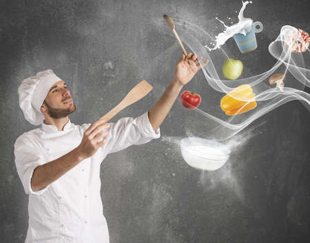 magician hat: Chef creates a musical harmony with food Stock Photo