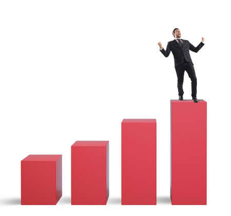 exult: Successful businessman on the top of a statistic bar