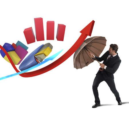 impuestos: Estadísticas desafío de un hombre de negocios con paraguas