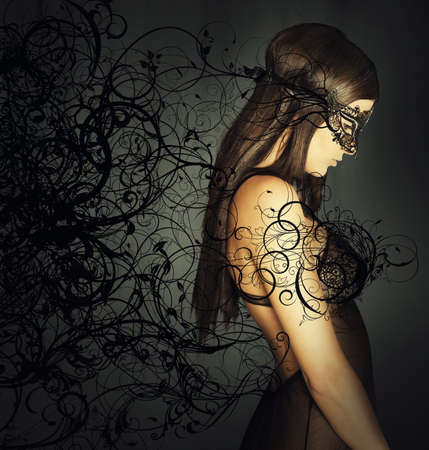 erotic fantasy: Seductive woman hiding her face with a mask Stock Photo