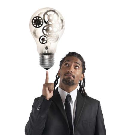 mechanisms: Businessman has a great idea with mechanisms Stock Photo