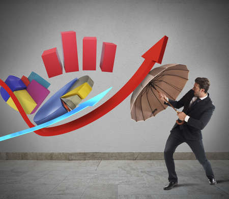financial protection: Statistic challenge of a businessman with umbrella Stock Photo