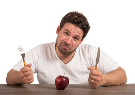 man only: Sad fat man eating only an apple Stock Photo