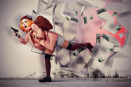 trickster: Woman clown thief breaks the bank vault