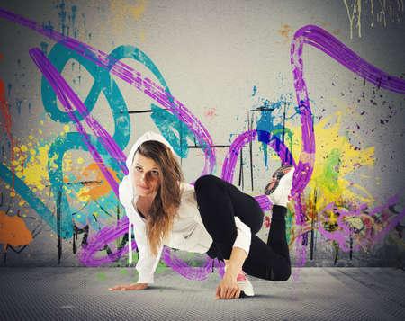 breakdance: Street agile ballerina with hoody dance breakdance
