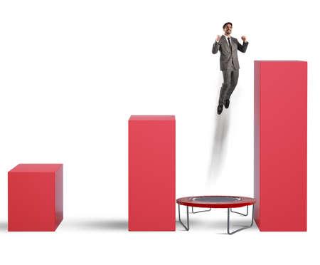 increasingly: L'uomo salta tra le statistiche sul trampolino Archivio Fotografico