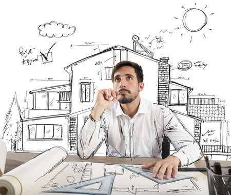 architect plans: Architect thinks how to design a house Stock Photo