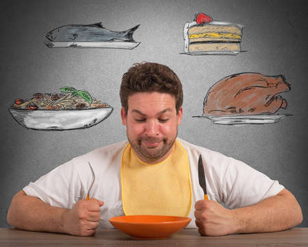 Hungry man thinks about what to eat Stock Photo