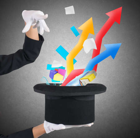 conjurer: Sorceress exits from hat arrows and graphs Stock Photo