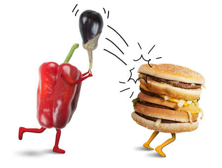 vegetarian hamburger: Pepper fight with a burger that escapes Stock Photo