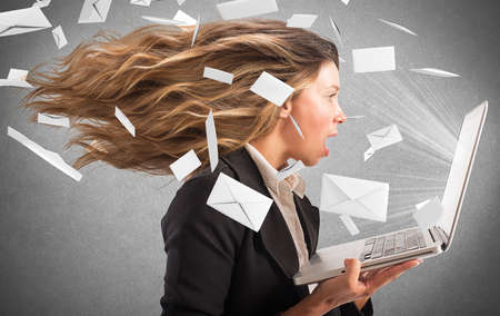 e work: Girl covered with a wind of email