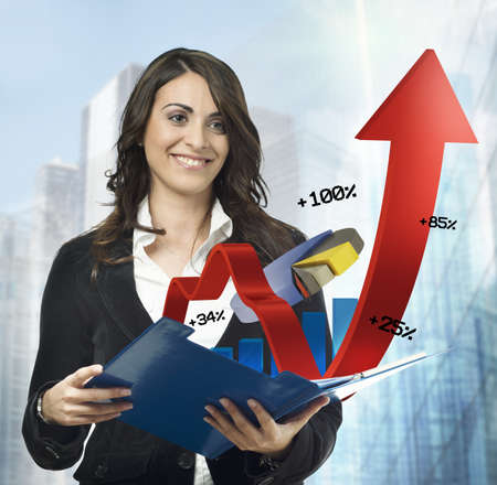 statistical: Businesswoman with statistical and financial charts notepad Stock Photo