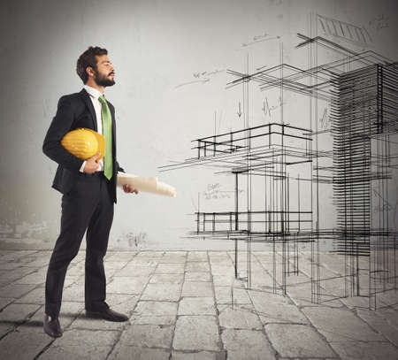 construction: Young architect imagines his new construction project Stock Photo