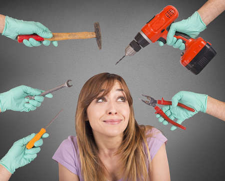 tools: Frightened girl from crazy tools of dentist Stock Photo